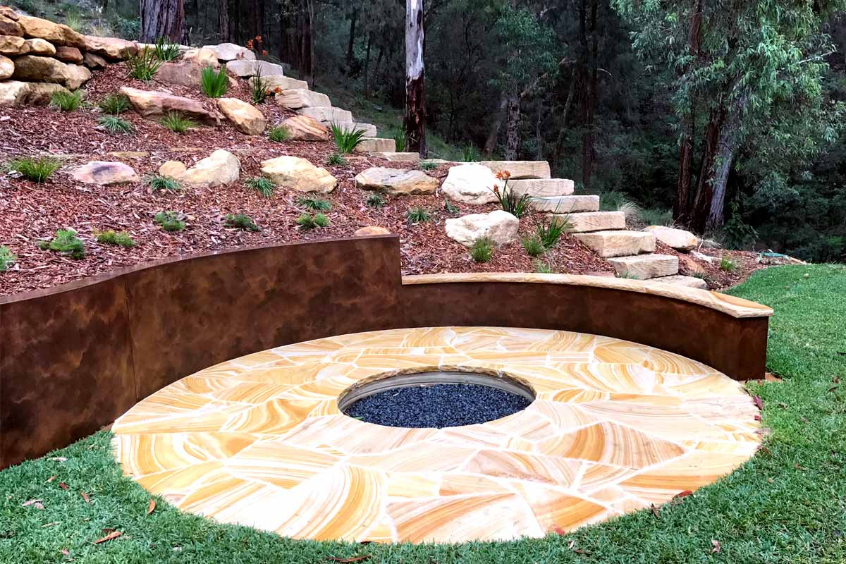 Fire Pit Design and Construction on Steep Block